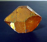 Photographs of a large golden healer crystal.