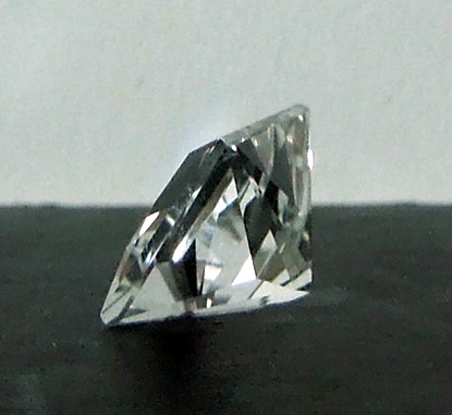 An 8x8 mm princess cut Herkimer diamond.