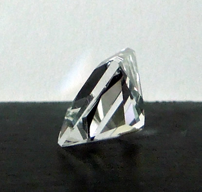 Side view of this 3.5 ct. clear cut quartz crystal.