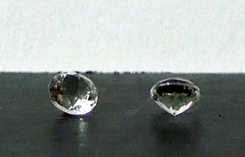 Machine faceted Herkimer accent gemstones.