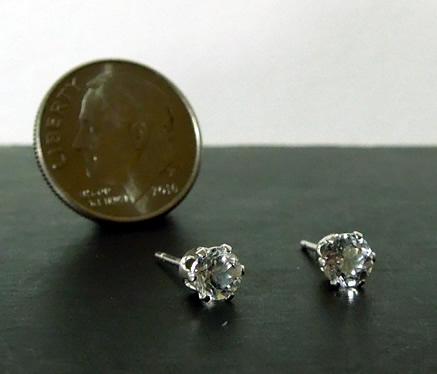 Size comparison of earrings to a dime.