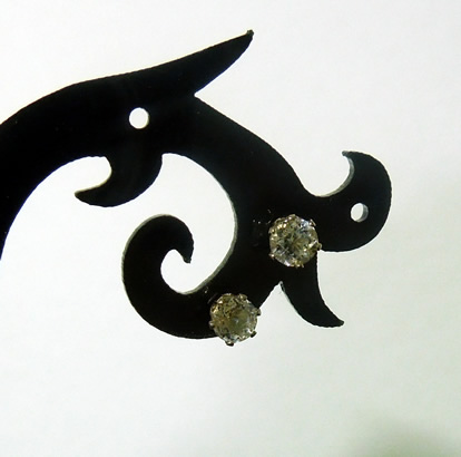 Front view of diamond ear studs.