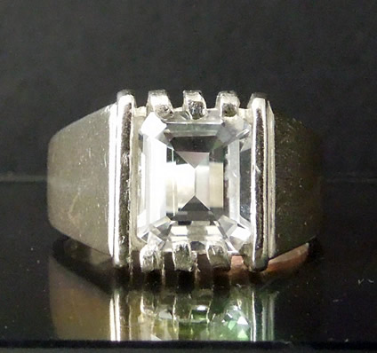 Mens emerald cut solitaire diamond ring.