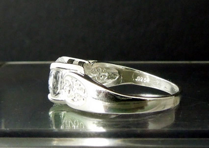 Side view shows sterling silver stamp.