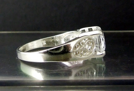 Side view of a unusual diamond promise ring.