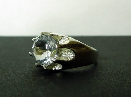 Brilliant round mens crystal and sterling ring.