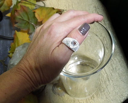 Ring shown on models hand.