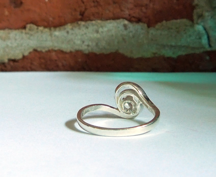 Back view of sterling silver swirl ring.