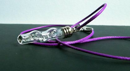 The AA grade crystal charm and the purple cord necklace.