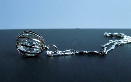 Side view of cage pendant.