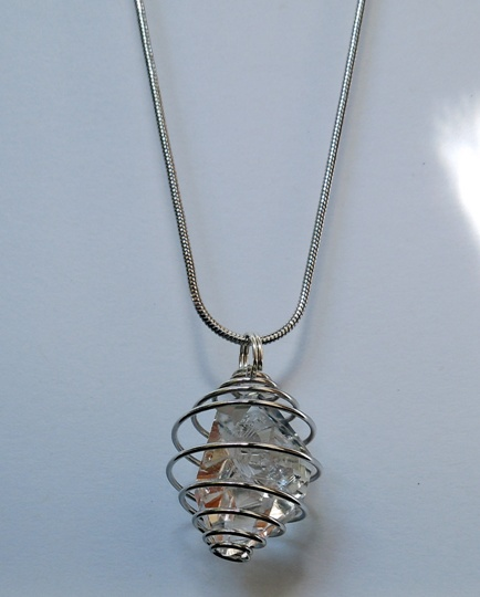 Pendant hangs from a silver chain.
