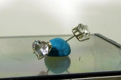 Heart cut diamond ear studs.