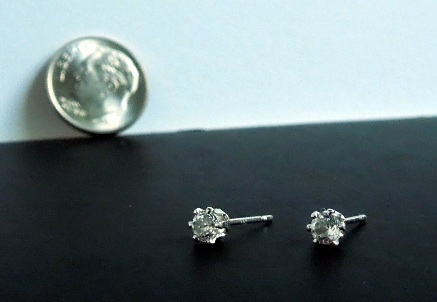 Silver and crystal post earrings.