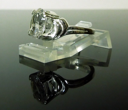 Side view of silver and crystal ring.