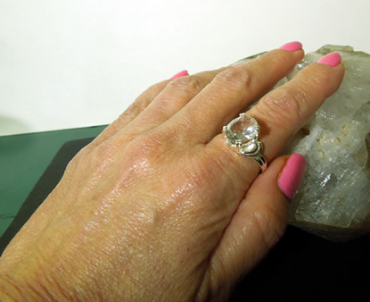 Sterling silver setting shown on my hand.