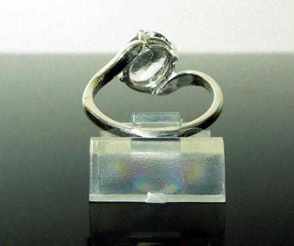 Back view of offset oval engagement ring.