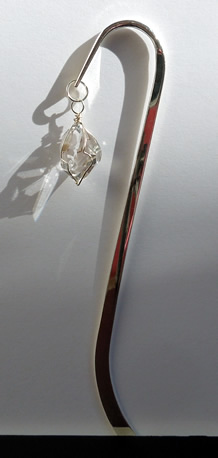Side view of hook style book mark.