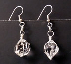 Large crystal and silver earrings.
