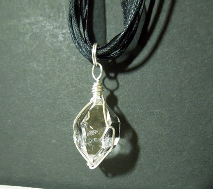 The black ribbion necklace really sets off the clear Herkimer.