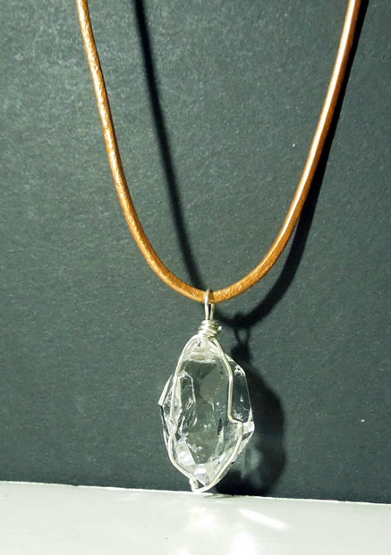 Beautiful natural crystal with a pendulum shape.