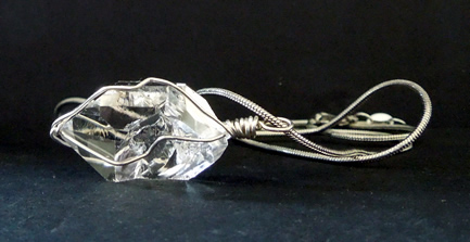 Wire wrapped sterling silver with silver chain.
