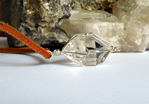 Images of a large clear Herkimer Diamond crystal pendant.