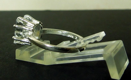 Side view of sterling and crystal ring.