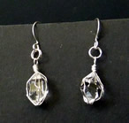 Silver wire wrapped quartz crystal earrings.