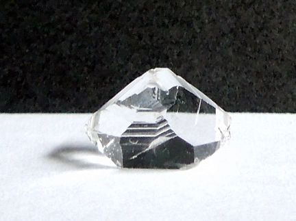 Large key covers top of crystal.