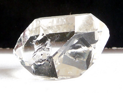 A 6.75 ct. double terminated quartz crystal enhydro.
