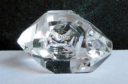 Key mark on raw Herkimer crystal.