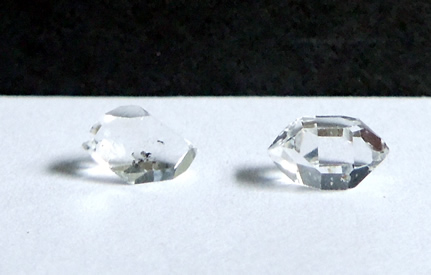 Two double terminated quartz crystal.