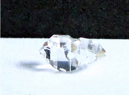 Penetration point is seen entering other quartz crystal.