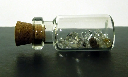 A glass bottle to hold the Herkimer Diamond clusters.