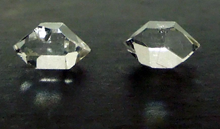Matching crystals measure 9 and 9.5 mm.