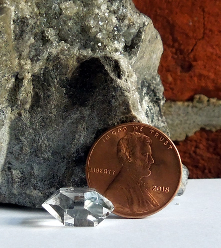 Herkimer photographed next to penny.