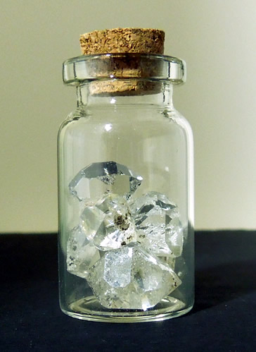 Small glass bottle full of crystals.