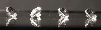 Four round cut crystals.