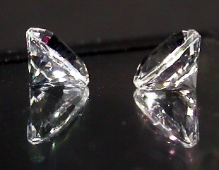 Set of two cut crystal gemstones.