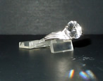 Brilliant round cut quartz crystal ring.