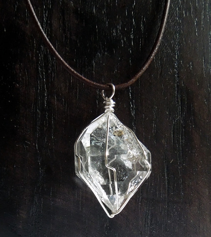 Herkimer Diamond wrapped in fine sterling silver wire.