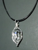Photos of a wire wrapped herkimer diamond pendant.