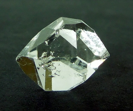 A water clear double terminated quartz crystal.
