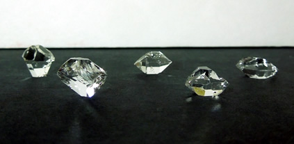 A wholesale group of double terminated quartz crystals.