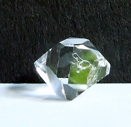 Crystal has a round or 'fatty' shape.