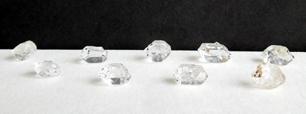 Group of clear crystals with double termination tips.