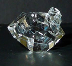 Water clear double terminated triplet crystal.