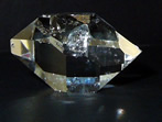 Large, clear, double terminated quartz crystal.