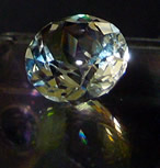 Brilliant round faceted Herkimer crystal.
