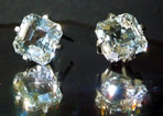 Large asscher cut crystal stud earrings.